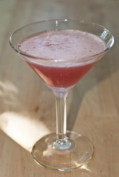 Mango Berry Martini     (1 oz Malibu Mango rum  1/2 oz cointreau  1/2 oz peach schnapps  1 oz cranberry juice  1 oz pineapple juice)