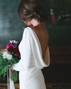 Classic wedding dress with sleeves by Martina Liana