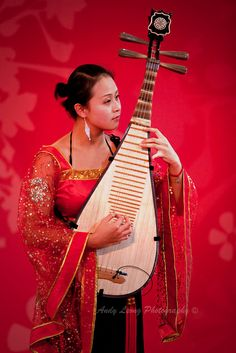 """Play Pipa - In the West a certain Tai Chi move is commonly called """"Play Guitar."""" In China it's called, """"Play Pipa."""" The pipa is a traditional four stringed, 30 fretted lute with a 2,000 year history. It is held upright and plucked forward (pi) and back (pa.)  #Tai Chi #Taijiquan"""