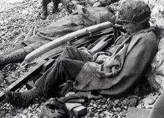 Two American soldiers rest against a chalk cliff on the beach of the Normandy coast of France after landing in Man at right is wrapped in blanket & soldier at left stretches out beside an inflatable belt he apparently wore while making his way ashore. World History, World War Ii, Ww2 History, D Day Invasion, Normandy Invasion, Landing Craft, History Magazine, American Soldiers, Military History