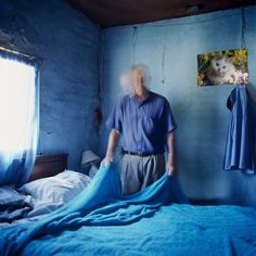 Alessandra Sanguinetti  ARGENTINA. Buenos Aires. 2010. Guillermina's father making his bed. He has just learned he is dying of cancer.