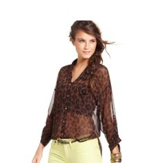 """Free people leopard blouse Super cute sheer chiffon button up blouse with a black and brown leopard print . Convertible sleeves. Shorter in front then a lower hanging back """"tale"""" that you can tuck in or wear over leggings. Worn once for a presentation like new. Free People Tops Blouses"""