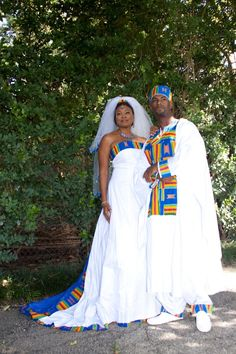 All-white wedding dress with blue geometrical patterns along the hemlines. on The Fashion Time  http://thefashiontime.com/37-gorgeous-african-wedding-dresses/#sg25