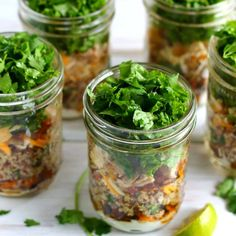 Grab one of these healthy, Chipotle-inspired burrito bowl mason jar salads for a filling and delicious lunch on-the-go.