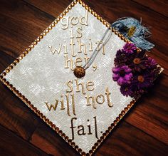 "My graduation cap for when I earned my bachelors degree. ""God is within her, she will not fail."" -Psalm 46:5"
