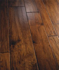 "The Amalfi Coast collection from Bella Cera is hand-carved, hand-distressed and dual hand-stained. Engineered from fine Hickory, Maple, Walnut and Cherry, the available color selections are hand-finished by flooring craftsmen. Amalfi comes prepackaged in a 4""/6""/8"" variable-width configuration with an impressive 50-year residential warranty."