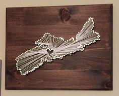 A little DIY Nova Scotia string art :) makes the house feel like home.