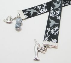 Black and Gray Hummingbird Ribbon Bookmark So very pretty! This lovely item features black ribbon with gray hummingbirds and white flowers. I added a hummingbird charm, bird charm and marbled beads. Ribbon Bookmarks, Black Ribbon, Christmas Sale, Hummingbird, White Flowers, Jewelery, Black And Grey, Arts And Crafts, Etsy Shop