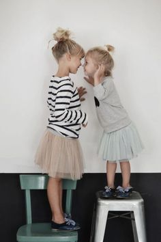 Like this shot for siblings! Simple background and side angle shot while standing on stools. So sweet.