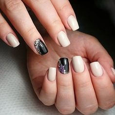 Very beautiful and stylish manicure made on the combination of black and light-beige varnishes. The nails of a medium length must be carefully crafted that