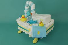 Our video and step by step guide will help you create the most adorable Stroller Diaper Cake; perfect as a baby shower gift or decoration! Duck Diapers, Baby Shower Diapers, Baby Shower Cakes, Baby Boy Shower, Baby Shower Presents, Baby Shower Parties, Baby Shower Gifts, Baby Showers, Diaper Cakes Tutorial