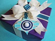 Easy No-Sew Fabric #Christmas Ornaments & Gift Toppers (http://blog.hgtv.com/design/2013/12/12/easy-no-sew-fabric-christmas-ornaments-gift-toppers/?soc=pinterest)