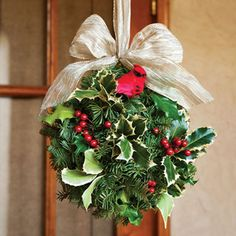 Made of fresh-cut noble fir, this beautiful and unique decoration will encourage plenty of Xs and Os to keep the season warm! Holly Berries, Red Berries, Yule Traditions, Christmas Holidays, Christmas Wreaths, Christmas Ideas, Kissing Ball, Holiday Gifts, Holiday Decor