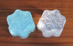 Glittery Snowflake Soap - Use glycerin soap base to make pretty soap shapes. A set of these with a pretty towel or dish would make a great hostess, teacher or secret-santa gift.