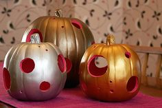 Carve the hole of your pumpkin lantern from the bottom, remove innards and carve holes along the sides. Then, paint the inside with one color paint, the outside with another and place it over a Pumpkin Masters LED pumpkin light to preserve your pumpkin even longer! http://www.pumpkinmasters.com/lighting.asp (idea via Making it Lovely)