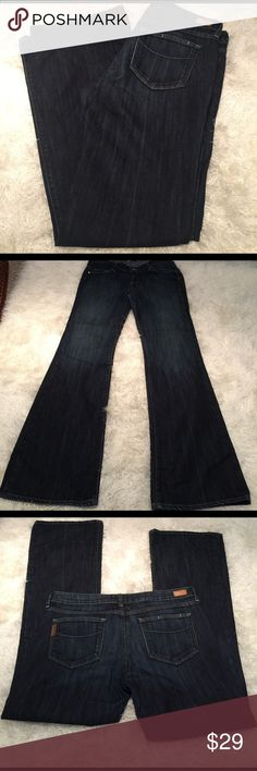 """Paige jeans sz 32 Great pair of Paige jeans. Gently pre owned & in very good condition. Extremely minor wear at ends. Dark wash. Boot cut. Fit is """"laurel canyon."""" Inseam measures 33 inches. Bundling is fun; check out my other items! No price talk in comments. No trades or holds. Paige Jeans Jeans Boot Cut"""