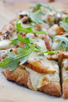A pizza bursting with juicy pears, tangy blue cheese, toasted walnuts, sweet caramelized onions and peppery arugula.