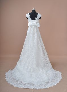 This stunning lace dress has a removable train, perfect for the entrance at the ceremony but easy to remove for dancing