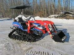 Ezike tractor with tracks and loader