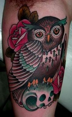owl tattoo on skull with rose