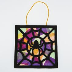 Black Spider Craft Kit - OrientalTrading.com  easily recreated with black paper and tissue paper.