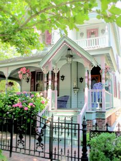 I say this to a lot of houses, but this is the most gorgeous house!!!! I want to live here!! Pastel green, pink, with flowers, pretty lamps and gorgeous balconies!!