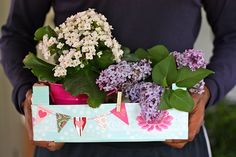 clementine box made into flower tote.  Genius!