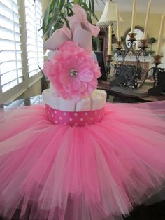baby tutu diaper cake with ballet shoes and matching head band.