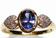 Tanzanite and Diamond accent ring set in yellow by Michaelangelas, $349.50  Free worldwide shipping & sizing!