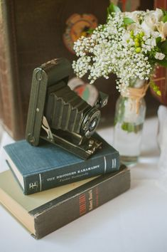 BOOKS + Vintage camera centerpiece - Rustic Wedding Reception at Pecan Grove from Day 7 Photography