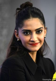 The beautiful Sonam Kapoor with red hot lips and winged eyeliner. via Voompla.com