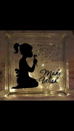 such a cute gift.  Would be great for a night light in kids rooms, or a decoration in the kitchen/ living area.  Glass block from home depot i think.