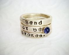 """Bend Or Be Broken Stackable Ring Set With Iolite This is a set of three sterling silver stackable rings with the hand-stamped saying """"Bend Or Be Broken"""" and bezel set iolite. This stackable set of three rings is a size Three Rings, Stackable Rings, Ber, Handcrafted Jewelry, Hand Stamped, Jewelry Crafts, Class Ring, Jewelry Design, Wedding Rings"""