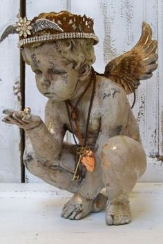Cherub decorated in a French santos inspired way. Anita Spero