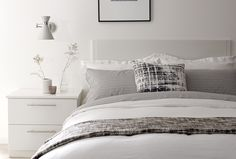 White, black and grey bedroom furniture and accessories create a stylish and elegant interior