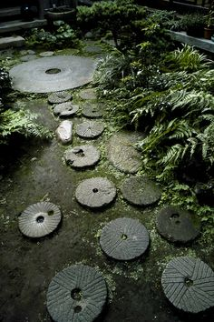 An example of mitate in jiyugaoka, tokyo. Reimagining old materials (old rice mills) in a new way (as stepping stones).