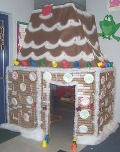 Recycled cardboard rolls, toilet paper rolls, paper towel rolls or wrapping paper rolls make for a great DIY ginger bread house with other added accessories.