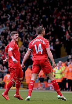 Liverpool's Jordan Henderson (R) celebrates scoring their first goal in their 2-1 win against Manchester City at Anfield on March 1, 2015