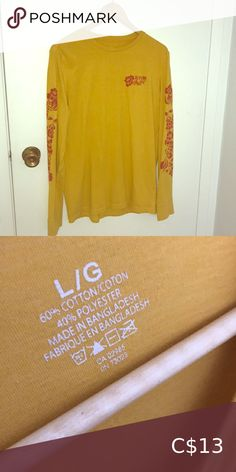 Long sleeves yellow shirt The condition of this item is really great. It looks better tucked in jeans. Yellow Shirts, Paper Shopping Bag, Long Sleeve Tees, Product Description, Jeans, Sleeves, How To Make, Closet, Things To Sell
