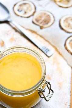 Meyer Lemon Curd in a jar, caramelized lemons on a baking sheet
