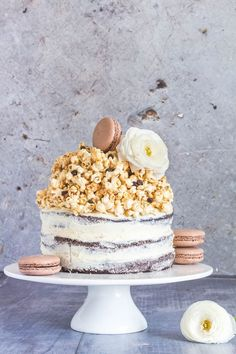 The best naked chocolate layer cake with caramel chocolate chip popcorn, chocolate chunks and a vanilla buttercream icing. A triple chocolate cake recipe   Recipes From A Pantry
