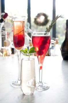 3 champagne cocktails. The raspberry lambic + raspberry liqueur + sparkling wine + rosemary sprig, yum.