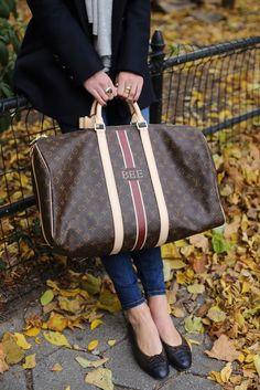 Top: Saint James. Denim: Current/Elliott. Shoes: Chanel. Jacket: ALC via Neiman Marcus. Scarf: Calypso. Weekender: Louis Vuitton. Jewelry: Bauble Bar and Cartier.