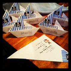 Pirate themed origami sail boat invites. I found how to make origami via pinterest search.  I added lines, pictures and wording with different fonts I found searching Fonts on pinterest.  I made all this on Microsoft word.