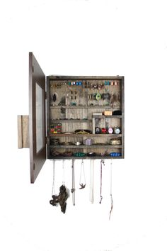This Jewelry organizer/closet is pretty awesome. Now, if I could only convince my dad to make me one.
