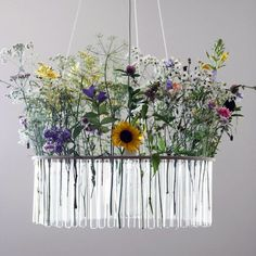 Let's make these SDe!!   20 DIY Chandeliers to Brighten Up Your Space | Brit + Co.