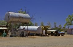 Trucks, storage tanks; Curtin Springs Station, New Territory, Australia.  January 2014.