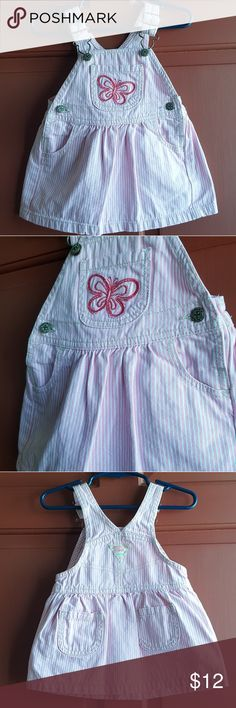 Osh Kosh B'Gosh Classic Style Overalls Dress 12m VVGUC! VERY minimal ww. Pink and white striped classic style overall dress with embroidered butterfly by Osh Kosh B'Gosh! Size 12 months  *10% OFF (or more) when you bundle any of my listings! Kids, Mens, and womens! Saves on shipping too! *Tons more on Mercari! No duplicates! Will not bundle between sites. OshKosh B'gosh Dresses Casual
