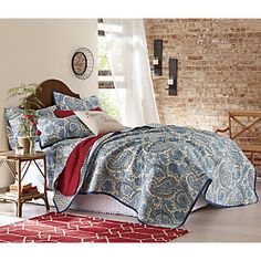 Santaney Oversized/Reversible Quilt - A striking paisley pattern in shades of blue on white swirls across the face of the Santaney Oversized/Reversible Quilt, Sham and Sheets. www.countrydoor.com
