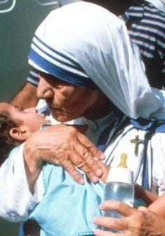 Image result for Mother of Teresa taking care of injured